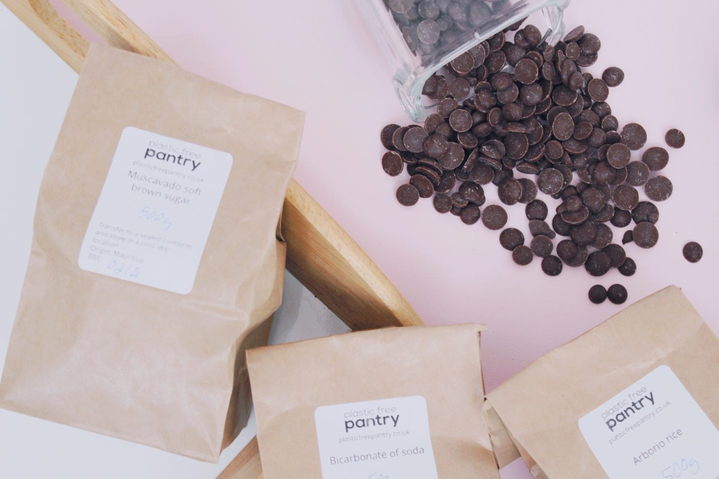 zero-waste pantry staples - sugar, chocolate drops, rice, and bicarbonate of soda
