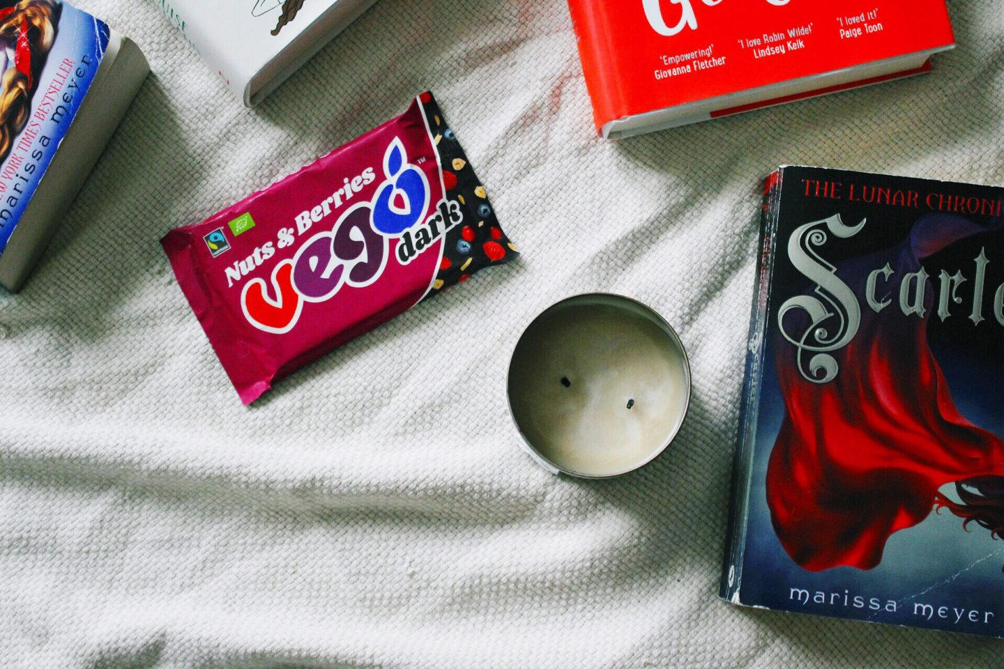 autumn books, candles, and chocolate